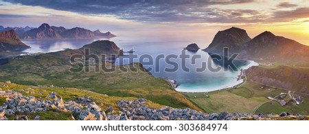 Norway. Panoramic view of  Lofoten Islands, located in Norway, taken from Holadsmelen, during summer sunset. - stock photo
