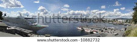 Norway. The Oslo skyline and harbour seen from Akershus castle (about 180 degrees wide panorama). - stock photo
