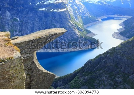 Norway tourism attraction - Trolltunga (Troll's Tongue) rock in Hordaland county. Ringedalsvatnet lake. - stock photo