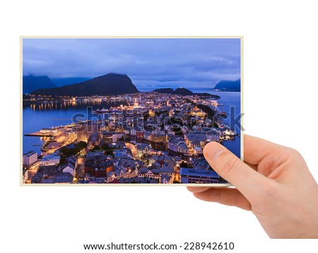 Norway travel photography in hand (Alesund) isolated on white background - stock photo