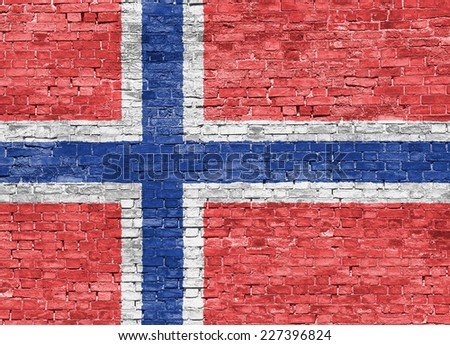 Norwegian flag over old brick wall - stock photo