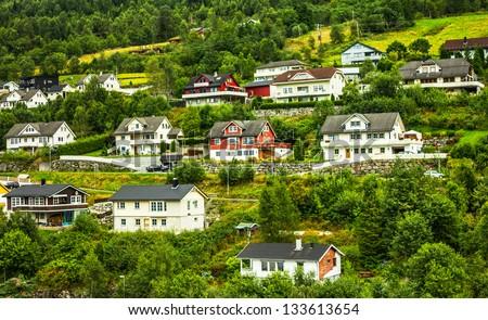 Norwegian houses in small town Olden. - stock photo