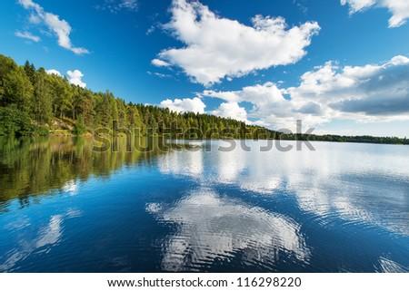 Norwegian landscape: Wild forrest and lake - stock photo
