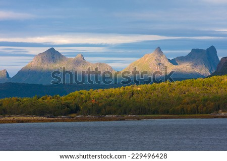 Norwegian mountains and fjord at dawn  - stock photo