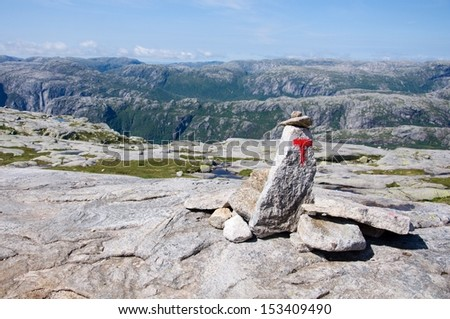 """Norwegian red """"T"""" hiking mark in mountains - stock photo"""