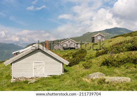 Norwegian typical grass roof mountain cabin�´s - stock photo