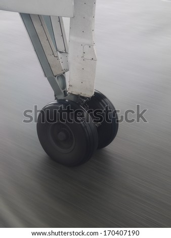 Nose landing wheel of a modern jet airliner close up - stock photo
