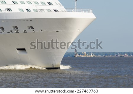 nose of a large cruise ship. White cruise liner leaving port of Saint Petersburg - stock photo