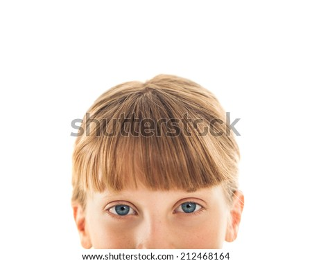 Nose-up shot of a blue-eyed Caucasian girl.