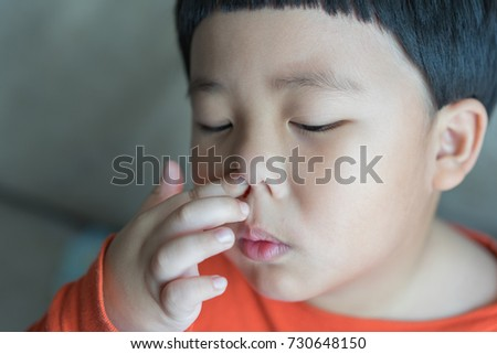 Nosebleed, A boy is bleeding from his nose.