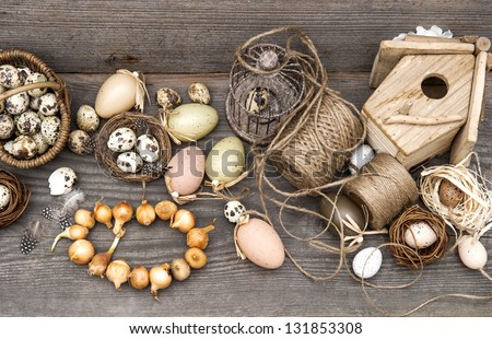 nostalgic easter still life home interior. vintage decoration with eggs and flower bulbs. wooden background - stock photo