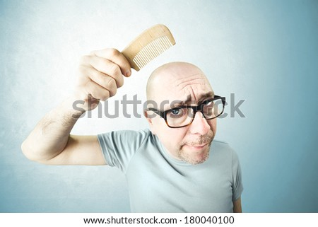 nostalgic man comb his bald head in the morning - stock photo