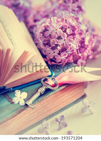 Nostalgic vintage background/ Vintage books,Photos of Memories and key with lilac flower - stock photo