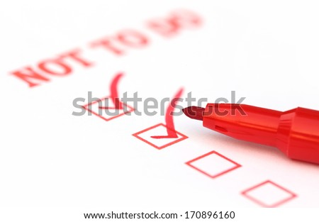 Not to Do Check List marked by red ink - stock photo