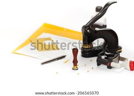 Notary public embosser, stamp, stapler. Selective focus. - stock photo