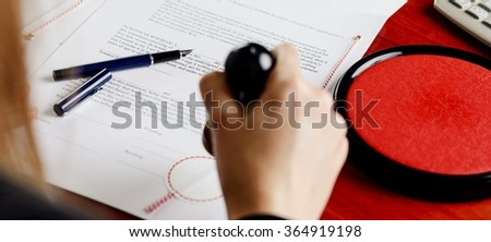 Notary public stamping document. Notary public accessories - stock photo