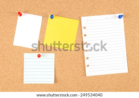 note and push pin isolated on cork board ready for your text.