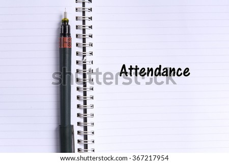 note book and a pen with ATTENDANCE word. Selective focus,shallow depth of field. - stock photo