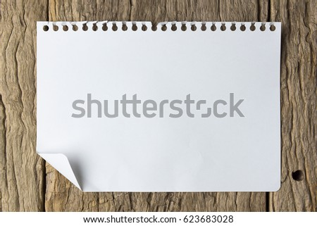 note book on grunge wood.