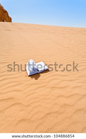 note book on sand dune hill of Wadi Rum desert, Jordan - stock photo