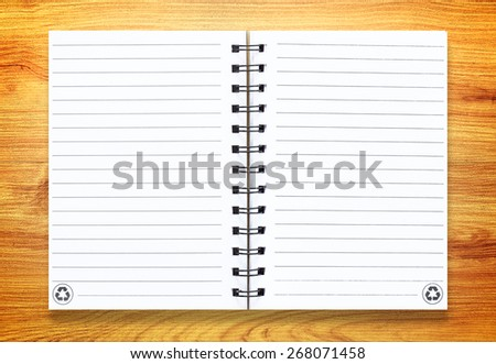 Note book on wood background