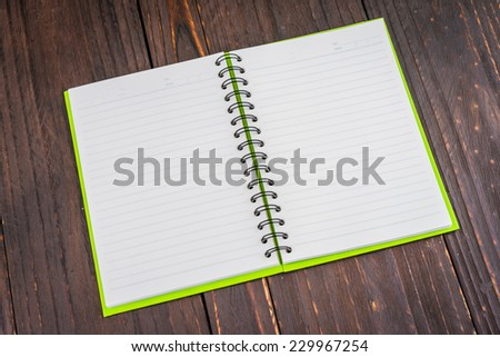 Note book on wooden background - vintage effect style picture - stock photo