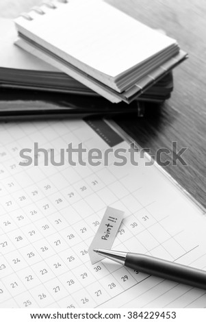 note book on wooden table with black and white color concept