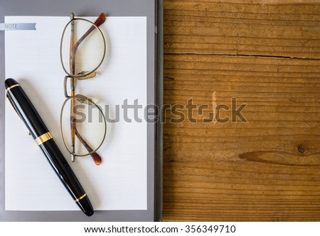 Note book paper with Fountain pen - stock photo