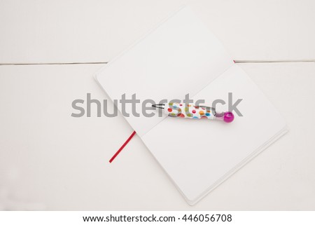 Note book with a pen - stock photo