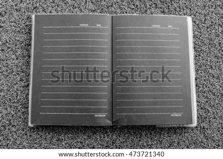 note book with black and white