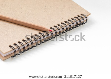 Note book with pencil on white