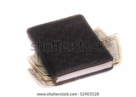 note-book with the money on a white background