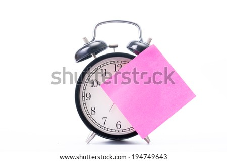 Note color paper stick on  alarm clock for notice something with white background