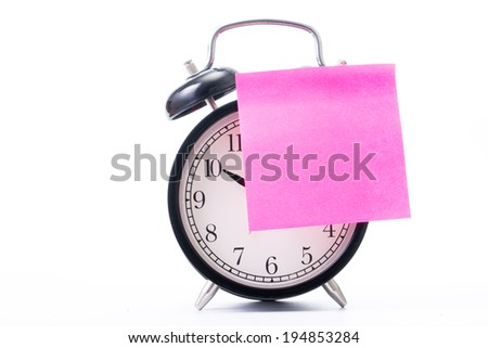 Note color paper stick on  alarm clock for notice something with white background - stock photo