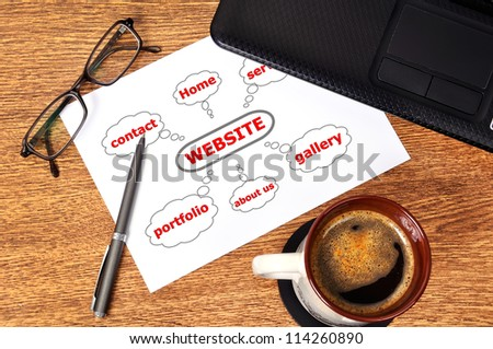 Note graph website on table businessman - stock photo