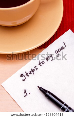 Note on a napkin, plan for achieving a goal - stock photo
