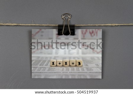 Note pad with synergy concept on a pinboard