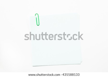 Note paper and paper clip isolate on white background.