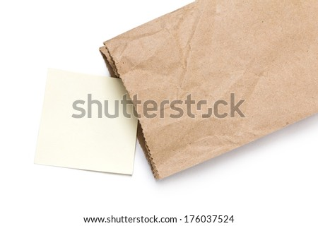Note paper in Brown paper bag on a White Background
