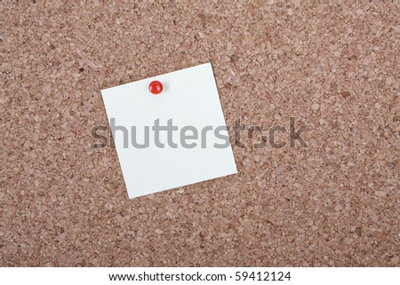 Note paper on a cork board - stock photo