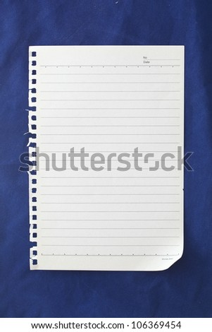 note paper on blue background