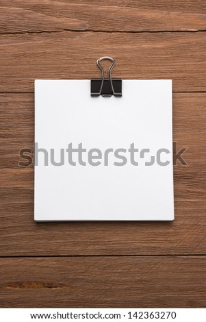 note paper on wood background - stock photo