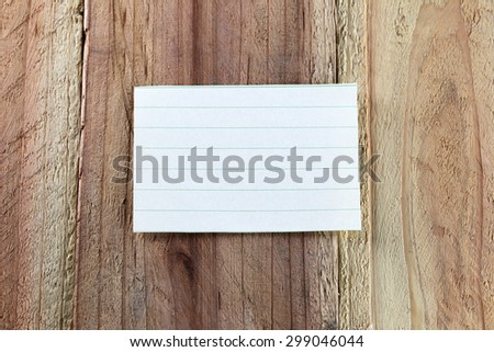 Note paper on wood background.