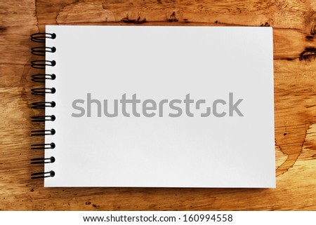note paper on wood texture background with copy space - stock photo