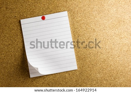 note paper pin on cork board background - stock photo
