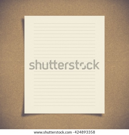 note paper with dash line on board background