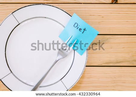 Note paper with diet attached to fork - stock photo
