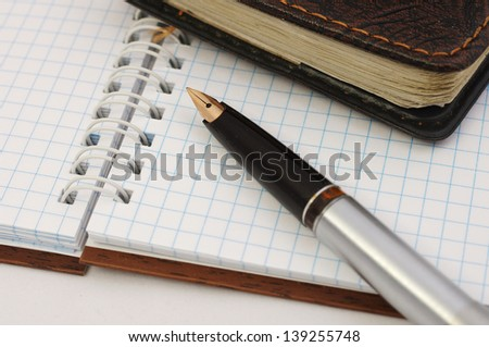 Note paper with pen