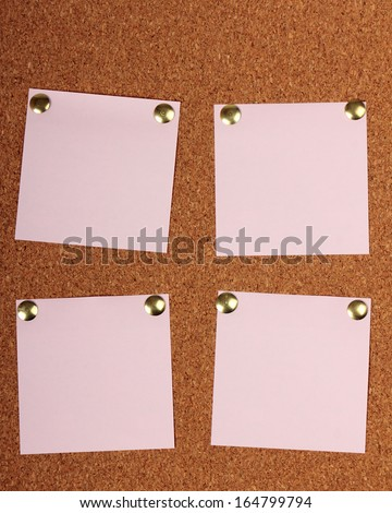 Note paper with pin on cork board