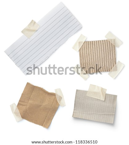 Note paper with tape isotade on white - stock photo